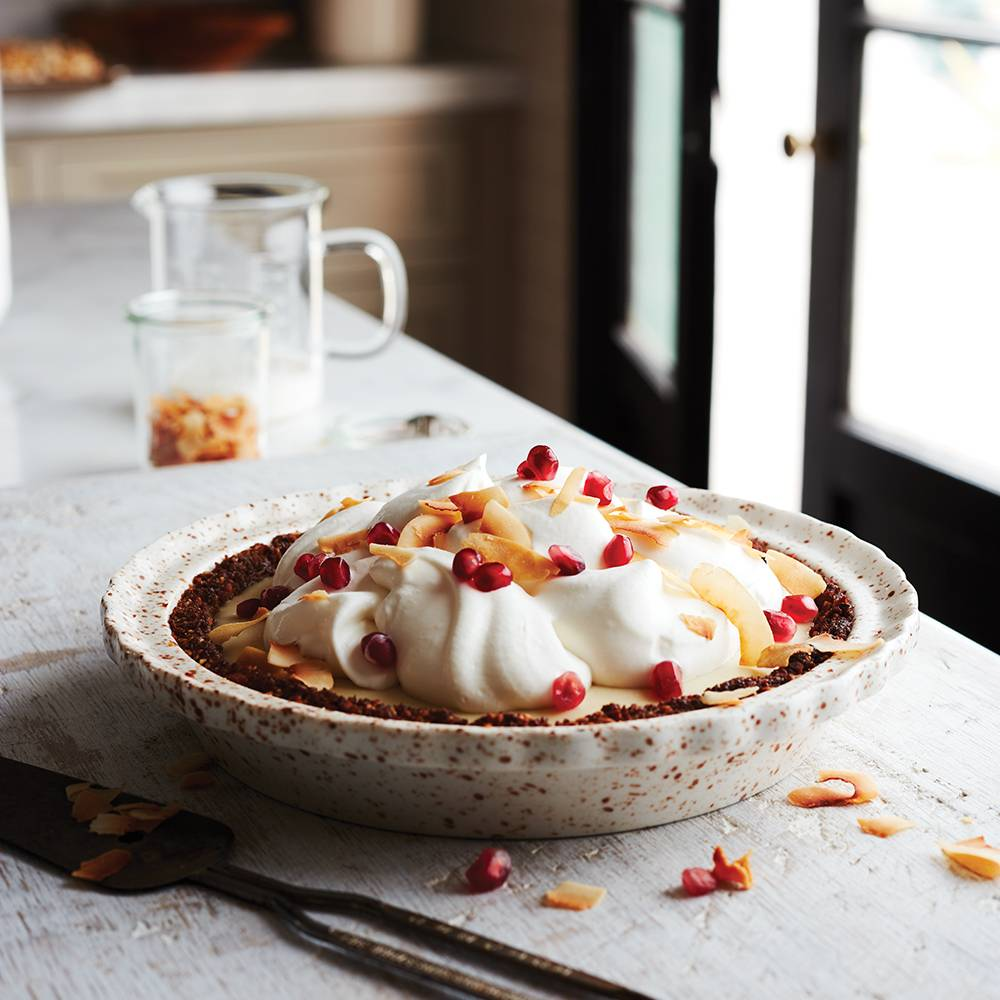 Pomegranate Coconut Cream Pie with Macadamia-Ginger Snap Crust